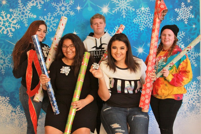 Juniors and Seniors enjoyed helping others wrap presents.
